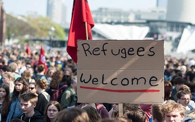 Біженці в Італії